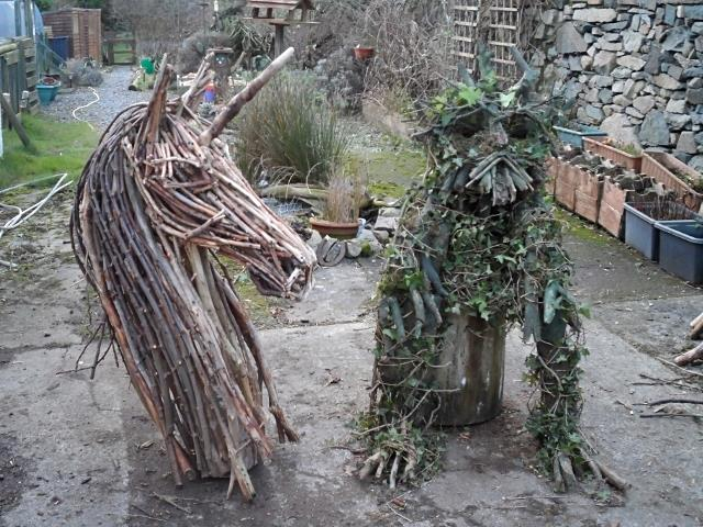 Unicorn and Green Man wild wood sculptures
